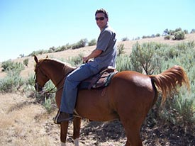 David riding a kind horse at a therapeutic boarding school